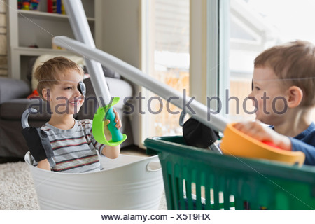 Boys playing pirates in living room - Stock Photo