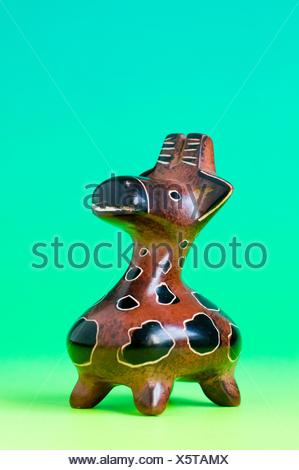 carved miniature soapstone giraffe - Stock Photo