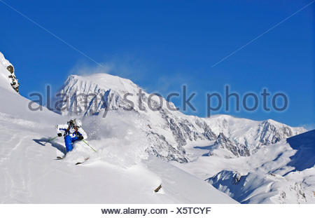skier off-piste skiing with Mont Blanc in the back, France, La Rosiere - Stock Photo