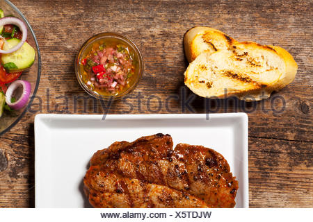 pork steak with chimichurri sauce - Stock Photo