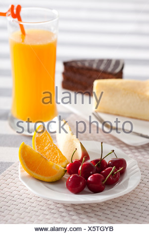 Fruit with juice and cakes - Stock Photo