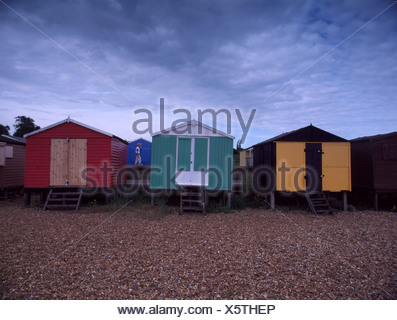 Brightly coloured beach huts Whitstable seafront Kent UK - Stock Photo
