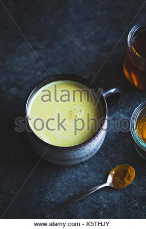 Golden Milk - Mixed honey, turmeric, ginger, cardamom, and cinnamon - Stock Photo