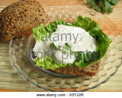 bread roll kaiser herbs sandwich deficient in calories curd curds healthfully - Stock Photo
