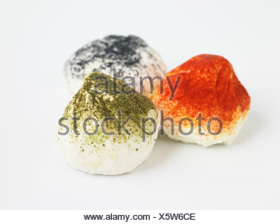 French Figuette goat's cheeses on white background, ash, paprika and tarragon, close-up - Stock Photo