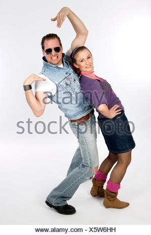 Woman and man dressed in 80s style - Stock Photo