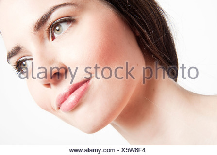 Portrait of a young dark-haired woman - Stock Photo