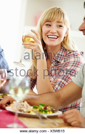 Young Woman Relaxing At Dinner Party - Stock Photo
