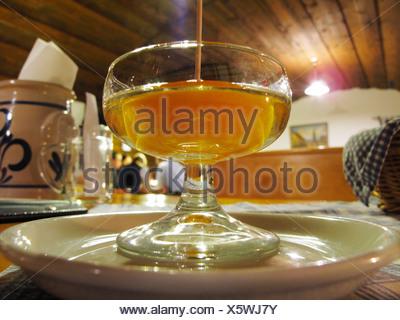 Apricot with a shot of apricot brandy, Stockinger Heuriger wine tavern in Duernstein, Wachau, Waldviertel, Forest Quarter - Stock Photo