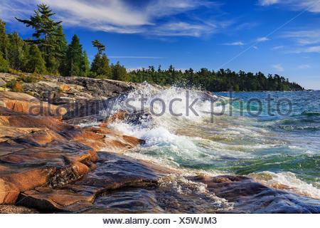 Waves crashing on rocks on Lake Superior at Catherine Cove, Lake Superior Provincial Park, Ontario, Canada - Stock Photo