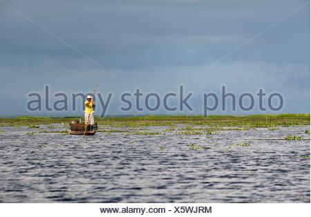 Thailand, Patthalung, Tale Noi, Fisherman on boat with fish traps - Stock Photo