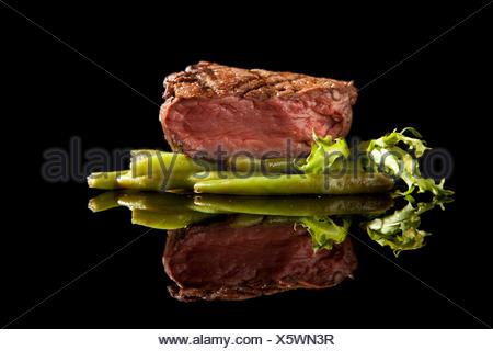 beef steak medium rare on black background - Stock Photo