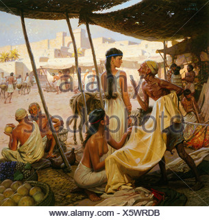 Abraham's wife, Sarai, and a slave bargain for cloth in a marketplace. - Stock Photo