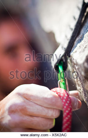 A man sport climbing in the Canadian Rockies. Snake Eyes, 10c, Cougar Creek, Canmore, Alberta, Canada - Stock Photo