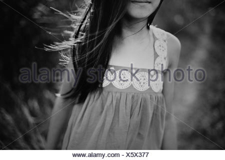 Girl (8-9) with wind tousled hair - Stock Photo