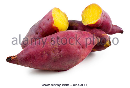 Cooked whole and halved purple sweet potatoes. - Stock Photo