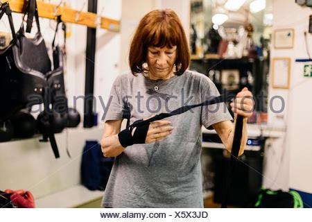 Senior woman preparing for boxing training - Stock Photo