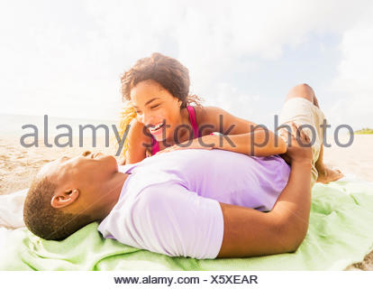 Young couple relaxing on beach - Stock Photo