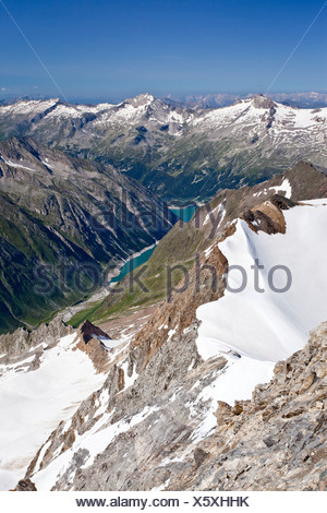 View from Mt. Hochfeiler, Pfitschertal valley, in the back the Zillertal valley and Schlegeisspeicher reservoir, South Tyrol - Stock Photo