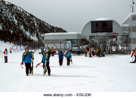 Skiers in front of cablecar, Speikboden, Ahrntal, South Tyrol, Italy, Europe - Stock Photo