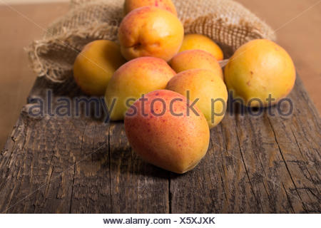 Close-Up Of Apricots On Wooden Planks - Stock Photo