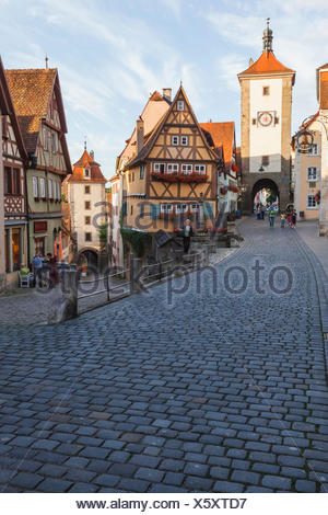 Germany, Bavaria, Romantic Road, Rothenburg-ob-der-Tauber, Ploenlein and Siebers Tower - Stock Photo