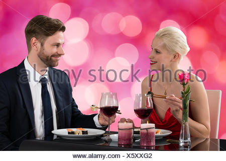 Couple Eating Sushi At Dinner - Stock Photo