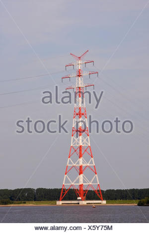 Pylons at Stade, power lines run across the Elbe, Stade, Lower Saxony - Stock Photo