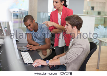 Business people working at computer in office - Stock Photo