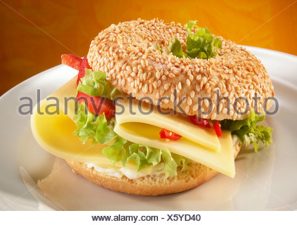 Sesame bagel topped with cheese - Stock Photo