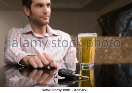 Car keys and a pint of lager - Stock Photo