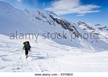 Ski mountaineers during ascent to Mt Staudenberg Joechl in Ridnaun above Schneeberg, Sterzing, South Tyrol, Italy, Europe - Stock Photo