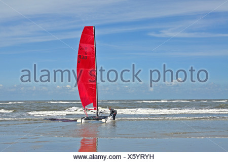 person launching a catamaran, Germany, Lower Saxony, East Frisia - Stock Photo