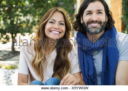 Portrait of smiling couple outdoors - Stock Photo
