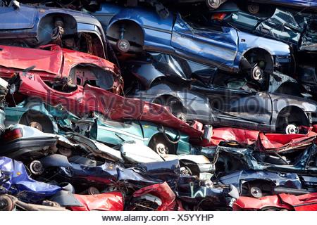 Old cars at a scrap yard - Stock Photo