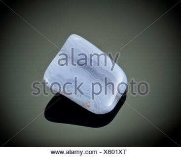Cutout of a blue lace agate gemstone on black background - Stock Photo