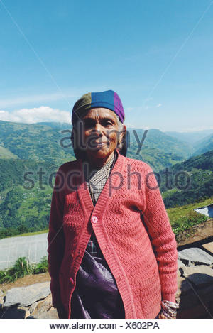 Portrait of woman standing in mountains - Stock Photo