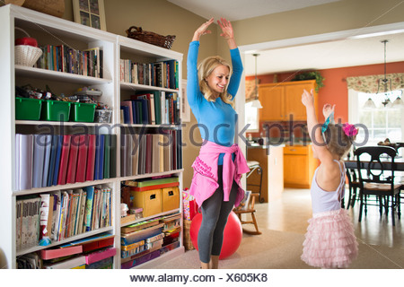 Mother and young daughter practicing ballet - Stock Photo