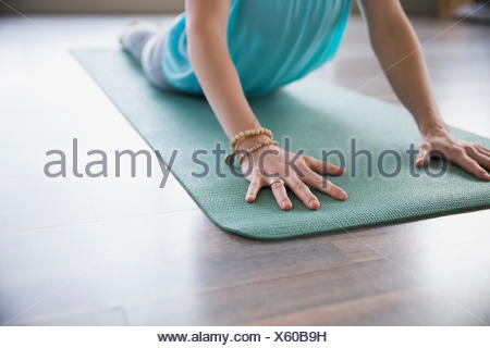 Woman practicing yoga in cobra pose - Stock Photo