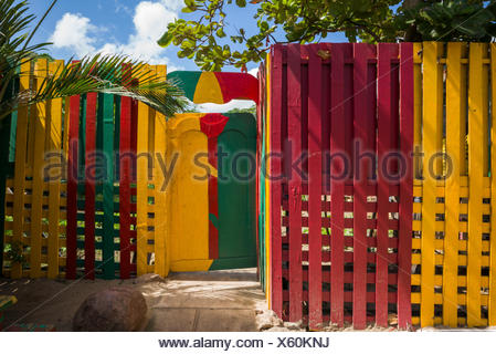St. Kitts and Nevis, Nevis, Pinneys Beach, colorful fence - Stock Photo