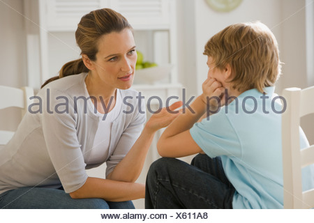 Mother having discussion with son - Stock Photo