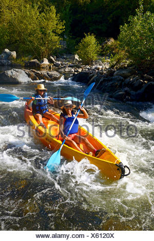 two women canoeing on the river Golo, France, Corsica, Bastia - Stock Photo