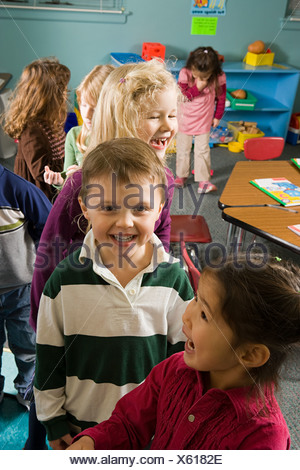 Children in a classroom - Stock Photo