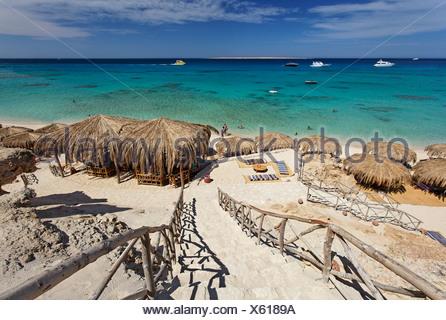 Beach, parasols, lagoon, swimmers, people, ships, Beach Mahmya, beach, Giftun Island, Hurghada, Egypt, Africa, Red Sea - Stock Photo