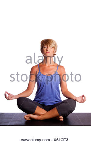 Beautiful woman in Gentle Seated Lotus Position, Padmasana, in yoga meditation to align chakra, on white. - Stock Photo