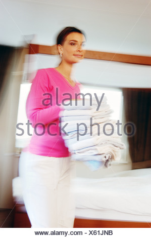 Blurred woman doing laundry - Stock Photo