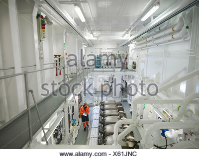 Engineer checks ship's engine - Stock Photo