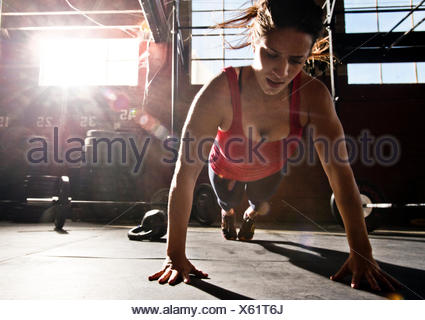 A crossfit athlete performs a push-up. - Stock Photo
