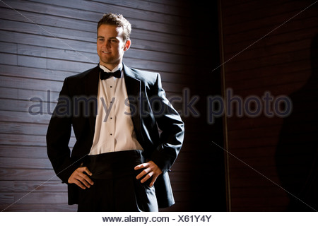 Young groom posing in tuxedo - Stock Photo