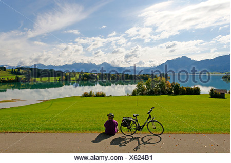 Forggensee lake in front of the Saeuling mountain, 2047 m, and the mountains of Thannheim, Bavarian Swabia, Bavaria, Germany Eu - Stock Photo